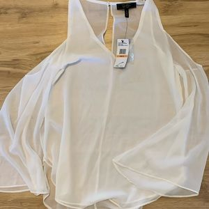 Sheer white Jessica Simpson bell sleeve top